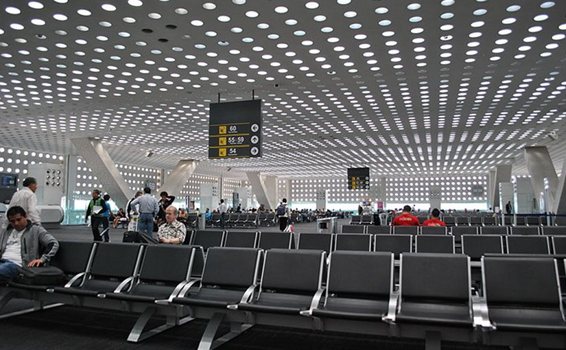 Departures waiting area in Terminal 2 of Mexico City International Airport (MEX) in Mexico City. Photo by ProtoplasmaKid, Wikipedia Commons.