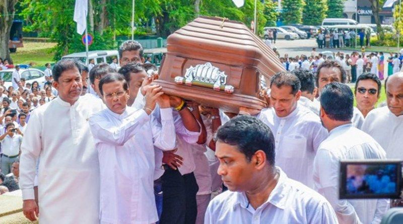 Sri Lanka's President Maithripala Sirisena carrying the remains of Maestro W D Amaradeva. Photo Credit: Sri Lanka government.