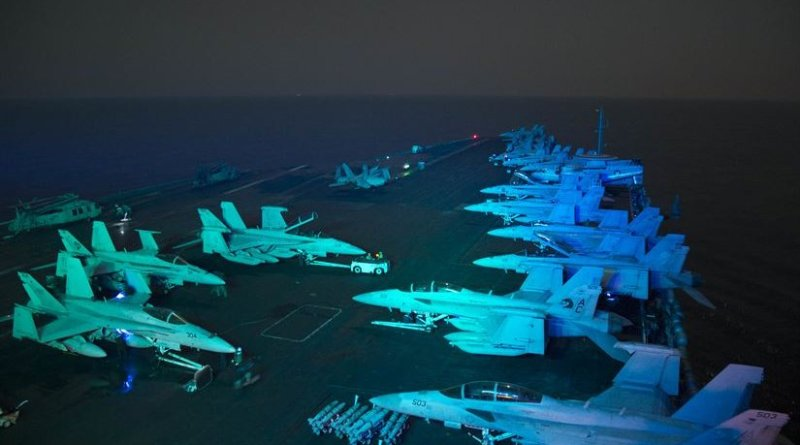 Sailors prepare for flight operations on the flight deck of the aircraft carrier USS Dwight D. Eisenhower in the Persian Gulf, Oct. 19, 2016. The Eisenhower Carrier Strike Group is deployed in support of Operation Inherent Resolve, maritime security operations and theater security cooperation efforts in the U.S. 5th Fleet area of operations. Navy photo by Seaman Dartez C. Williams
