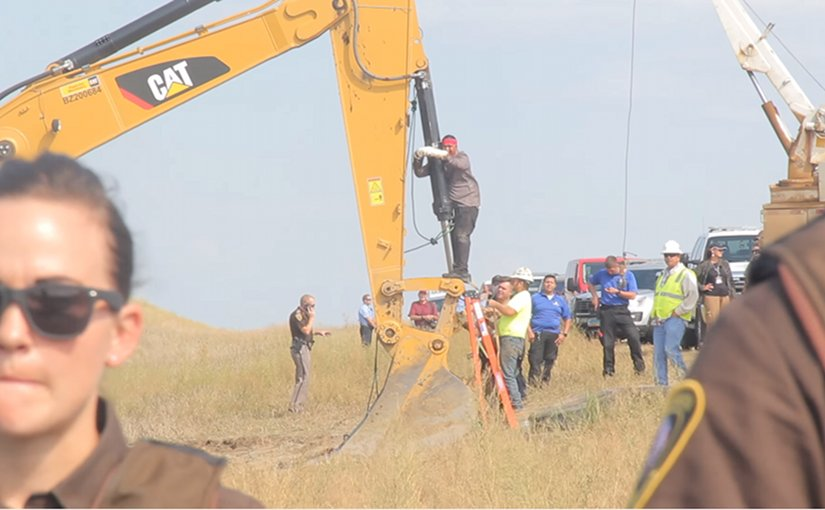 Lakota man locks himself to construction equipment to stop the construction of the Dakota Access Pipeline near the Standing Rock Indian Reservation in North Dakota. Photo by Desiree Kane, Wikipedia Commons.