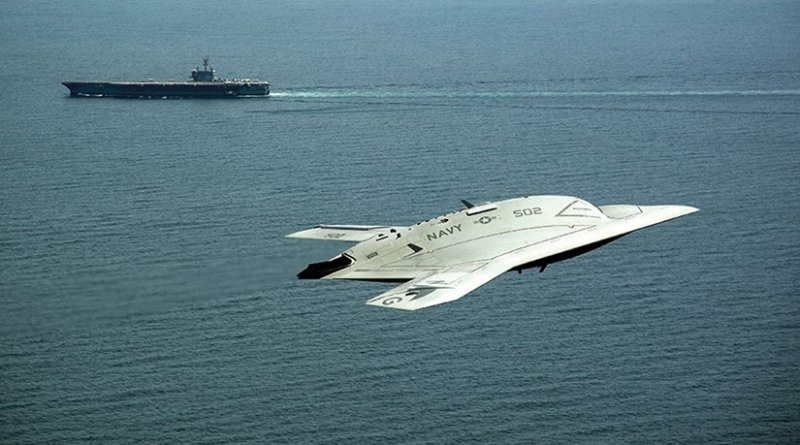 A drone, or Unmanned Combat Air System X-47B demonstrator flies near aircraft carrier USS George H.W. Bush, first aircraft carrier to successfully catapult launch unmanned aircraft from its flight deck, May 14, 2013 (U.S. Navy/Erik Hildebrandt)
