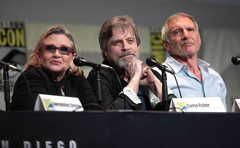 Carrie Fisher with fellow Star Wars actors Mark Hamill and Harrison Ford. Photo by Gage Skidmore, Wikipedia Commons.
