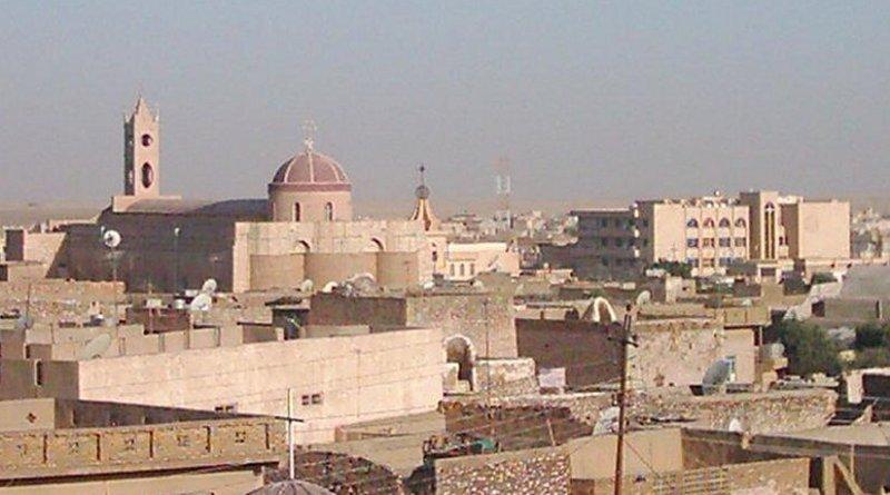 A view of Iraqi city Qaraqosh (Bakhdida). Photo by Chaldean, Wikipedia Commons.