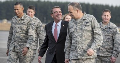 Defense Secretary Ash Carter speaks with Air Force Lt. Gen. Jerry Martinez, U.S. Forces Japan and 5th Air Force commander, after arriving at Yokota Air Base, Japan, Dec. 5, 2016. DOD photo by Air Force Tech. Sgt. Brigitte N. Brantley