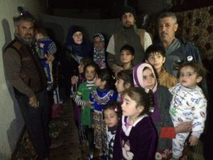 With families living on roadside near Najaf, Iraq. Photo by Cathy Breen.