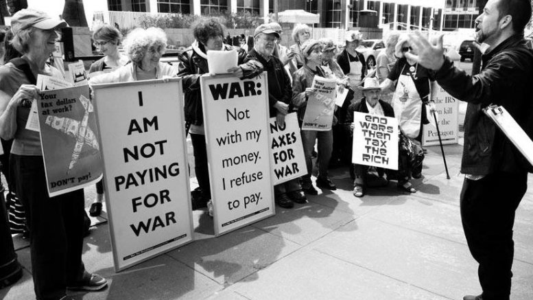 """War tax refusers in NYC 2016. Photo appears in the February/March edition of """"The Catholic Radical""""."""