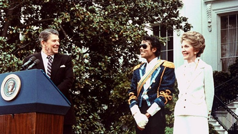 Michale Jackson at the White House being presented with an award by President Ronald Reagan and first lady Nancy Reagan. White House photo by Jack Kightlinger, Wikipedia Commons.