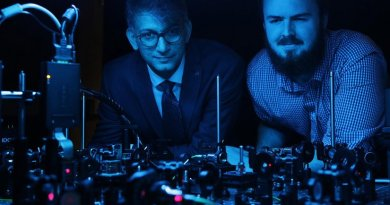 Professor Ebrahim Karimi, a member of uOttawa's Department of Physics and holder of the Canada Research Chair in Structured Light, and doctoral student Frédéric Bouchard observe the setup they used to clone the photons that transmit information, called qudits. Credit University of Ottawa