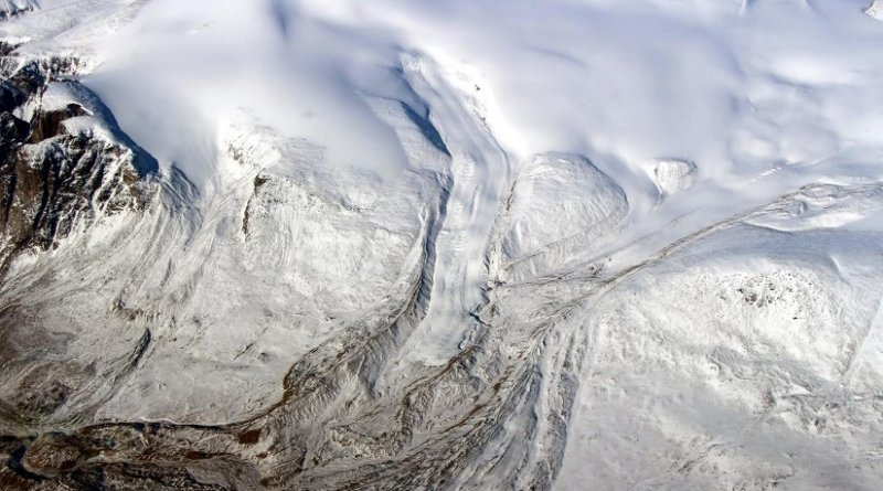 Canada's glaciers and ice caps are now a major contributor to sea level change, a new UCI study shows. Ten times more ice is melting annually due to warmer temperatures. Seen here is the edge of the Barnes Ice Cap in May 2015. Credit NASA / John Sonntag