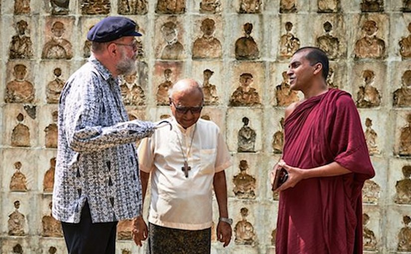Anglican Father Michael Lapsley speaks to Catholic priest and a Buddhist monk in Colombo on Feb. 28. (ucanews.com photo)