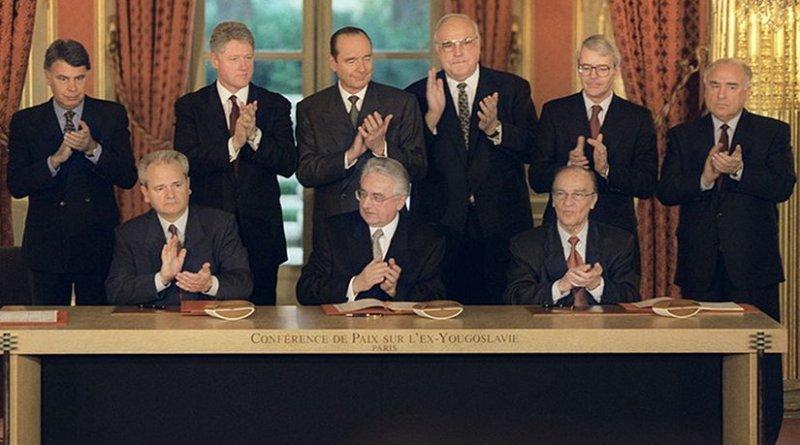 President of Serbia Milosevic, President of Croatia Tudjman, President of Bosnia Izetbegovic signing the Dayton Agreement. Photo Credit: NATO, Wikipedia Commons.