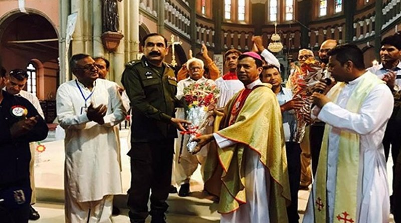 Archbishop Sebastian Francis Shah of Lahore presents security forces with bouquets at the Easter vigil Mass on April 16 to thank them after they foiled a terrorist attack. Photo Credit: ucanews.com