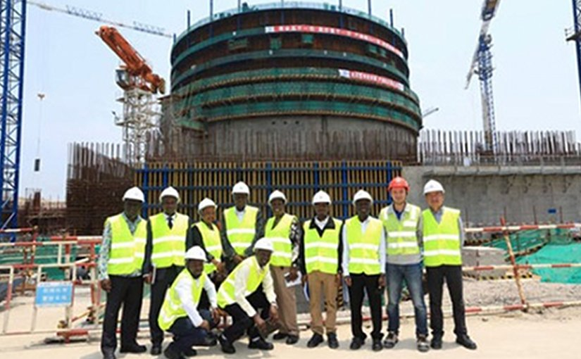 he Ugandan delegation at the construction site of a Hualong One unit at Fuqing (Image: CNNC)