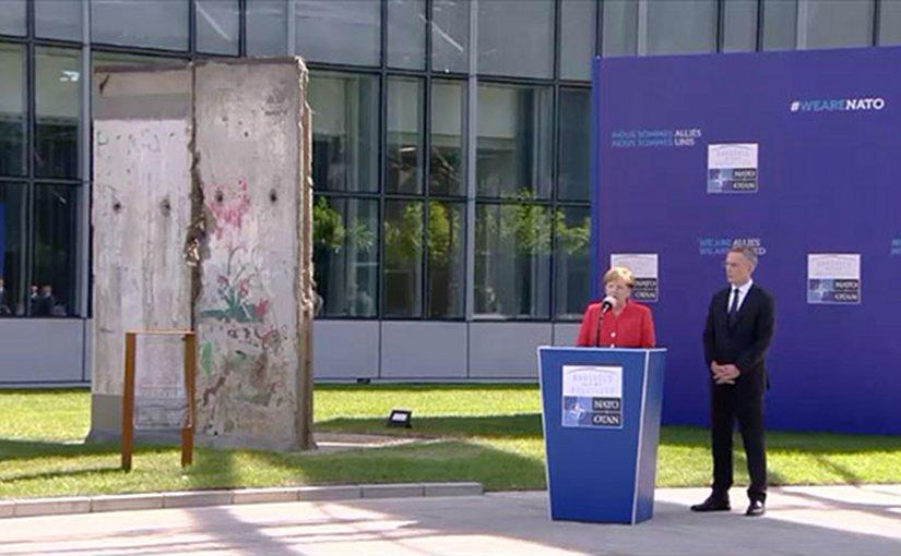 German Chancellor Angela Merkel with NATO Secretary General Jens Stoltenberg dedicating the Berlin Wall Memorial. Photo Credit: NATO