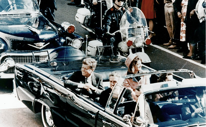 Picture of President Kennedy in the limousine in Dallas, Texas, on Main Street, minutes before the assassination. Also in the presidential limousine are Jackie Kennedy, Texas Governor John Connally, and his wife, Nellie. Photo by Walt Cisco, Dallas Morning News, Wikipedia Commons.