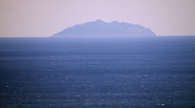 View of Okinoshima Island from Ōshima, Fukuoka, Japan. Photo by WashiTabi, Wikipedia Commons.