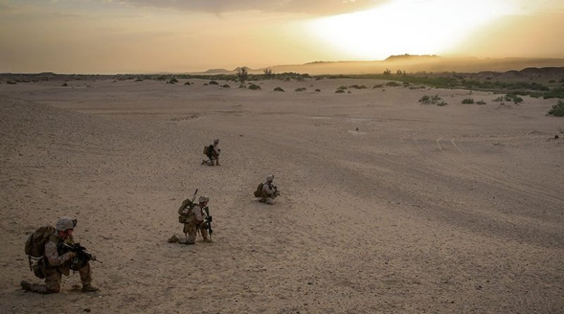 Marines with Bravo Company, 1st Battalion, 7th Marine Regiment, provide outboard security after offloading from CH-53E Super Stallion helicopter during mission in Helmand Province, May 1, 2014 (U.S. Marine Corps/Joseph Scanlan)