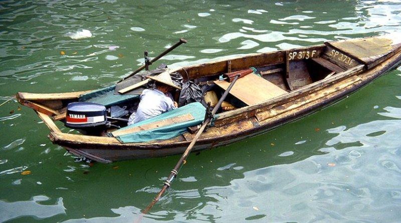 Small boat in Singapore harbor.