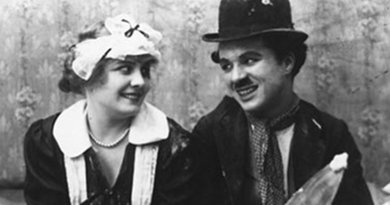 Still of Charlie Chaplin and Edna Purviance in the 1915 film Work.