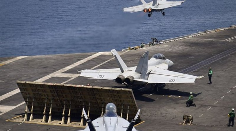 """n F/A-18F Super Hornet from the """"Black Knights"""" of Strike Fighter Squadron (VFA) 154 launches from the flight deck of the aircraft carrier USS Nimitz (CVN 68) while another Super Hornet from the """"Black Knights"""" and an EA-18G Growler from the """"Gray Wolves"""" of Electronic Attack Squadron (VAQ) 142 prepare to launch, July 29, 2017, in the Arabian Gulf. Nimitz is deployed in the U.S. 5th Fleet area of operations in support of Operation Inherent Resolve. While in this region, the ship and strike group are conducting maritime security operations to reassure allies and partners, preserve freedom of navigation, and maintain the free flow of commerce. (U.S. Navy photo by Mass Communication Specialist 3rd Class Weston A. Mohr/Released)"""