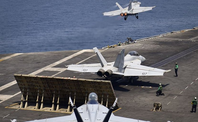 "n F/A-18F Super Hornet from the ""Black Knights"" of Strike Fighter Squadron (VFA) 154 launches from the flight deck of the aircraft carrier USS Nimitz (CVN 68) while another Super Hornet from the ""Black Knights"" and an EA-18G Growler from the ""Gray Wolves"" of Electronic Attack Squadron (VAQ) 142 prepare to launch, July 29, 2017, in the Arabian Gulf. Nimitz is deployed in the U.S. 5th Fleet area of operations in support of Operation Inherent Resolve. While in this region, the ship and strike group are conducting maritime security operations to reassure allies and partners, preserve freedom of navigation, and maintain the free flow of commerce. (U.S. Navy photo by Mass Communication Specialist 3rd Class Weston A. Mohr/Released)"