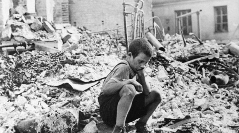 A young survivor of Nazi Germany's 1939 bombing of Warsaw. Poland has estimated that over $40bn of damage was done. [Julien Byrne/ Wikimedia]
