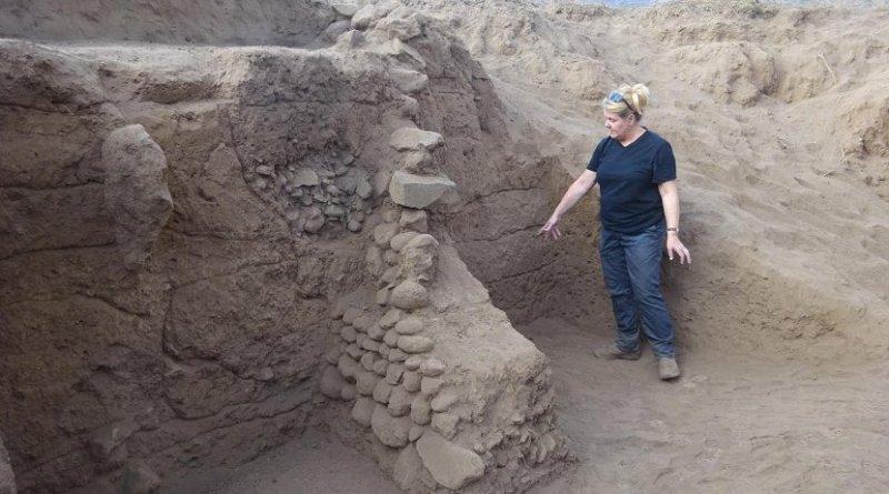 Carol Lang, University of York, examines the terrace systems of Engaruka. Credit University of York