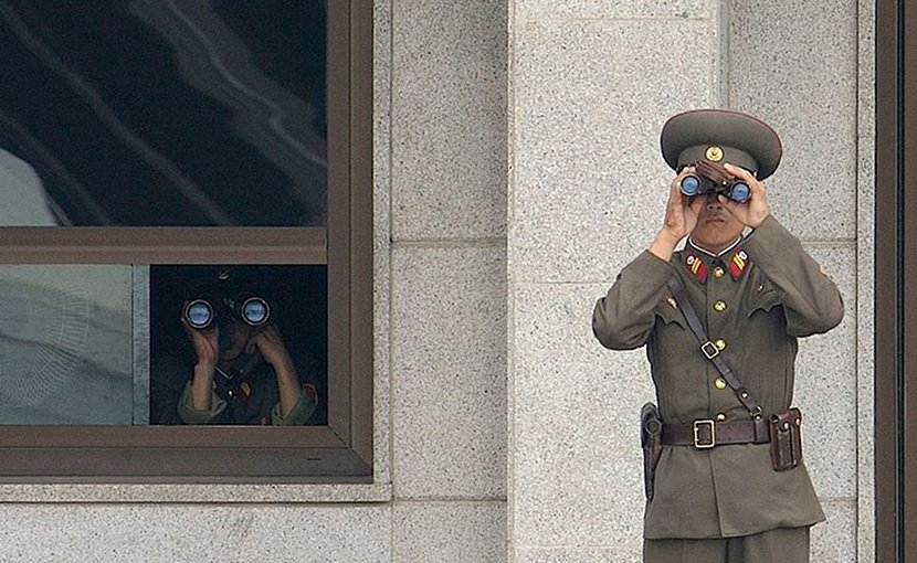 Soldiers from the North Korean People's Army look south while on duty in the Joint Security Area. Photo by Edward N. Johnson, US Military, Wikipedia Commons.