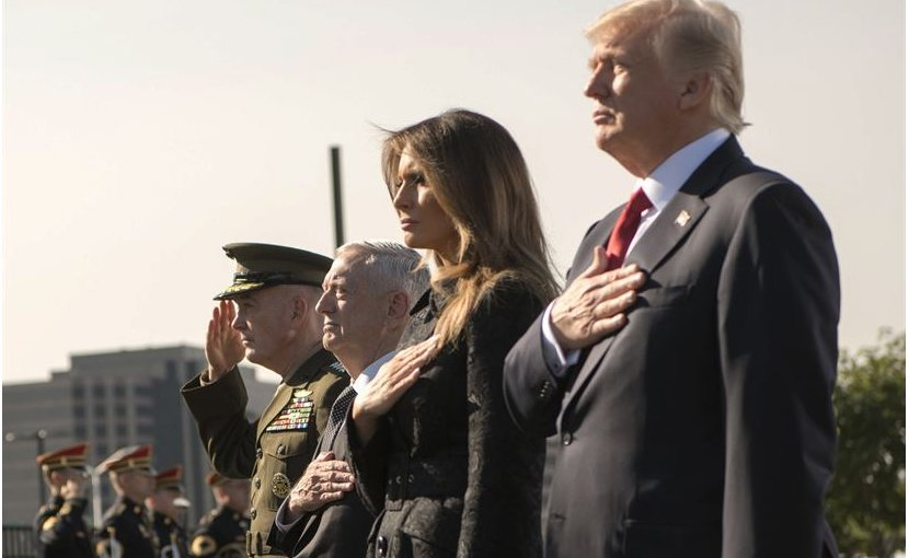 From left, Chairman of the Joint Chiefs of Staff Marine Corps Gen. Joe Dunford, Defense Secretary Jim Mattis, First Lady Melania Trump and President Donald J. Trump face the flag during the 9/11 Observance Ceremony at the Pentagon in Washington, D.C., Sept. 11, 2017. During the Sept. 11, 2001, attacks, 184 people were killed at the Pentagon. DoD photo by Air Force Tech. Sgt. Brigitte N. Brantley
