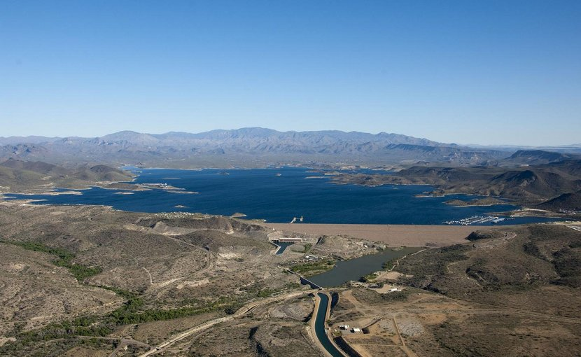 Evaporation-harvested energy can cut by half the water lost to natural evaporation, researchers say. Water-strapped cities with growing populations and energy needs could benefit most, including greater Phoenix, served by the above reservoir and irrigation system fed by the Colorado River. Credit Central Arizona Project