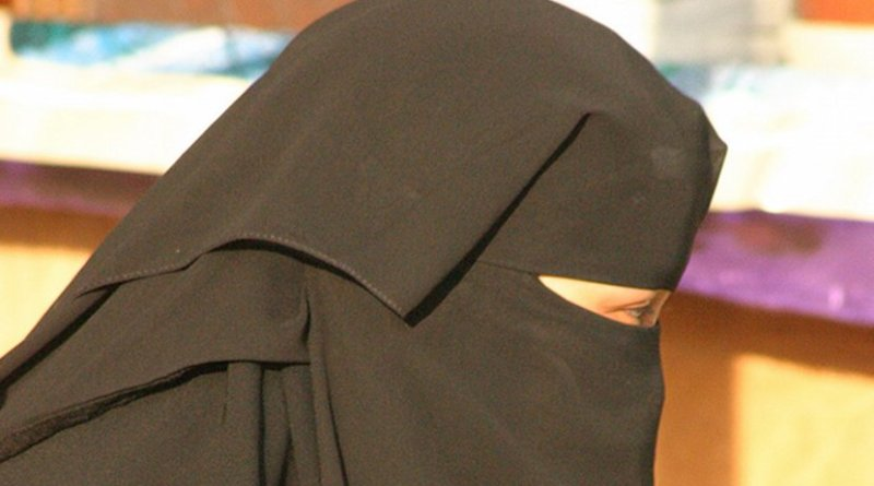 A Saudi woman wearing a traditional niqab. Photo by Walter Callens, Wikipedia Commons.
