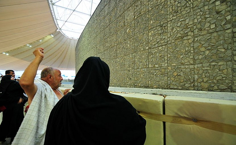 A man stones the Devil at the Mecca, Saudi Arabia. The ritual is a symbolic rite in which pebbles are thrown at pillars that represent the temptations of Satan. Photo by Fadi El Binni of Al Jazeera English, Wikipedia Commons.