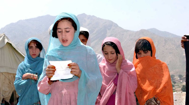 An Afghan school girl sings a prayer in celebration and for blessing. Photo Credit: US Army, Wikipedia Commons.