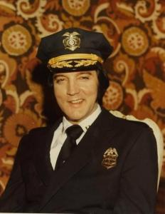 Elvis Presley posing in his Denver police uniform