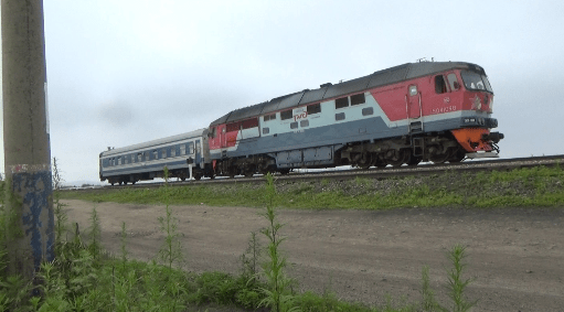Russian Railways locomotive pulling a passenger rail car headed for North  Korea. Photo by Leonid
