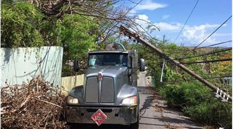 A fuel truck contracted by the Defense Logistics Agency makes its way through fallen electrical poles and downed trees in Puerto Rico, Oct. 17, 2017. Restoration efforts for power outages caused by Hurricanes Maria and Irma continue across the island. DoD photo