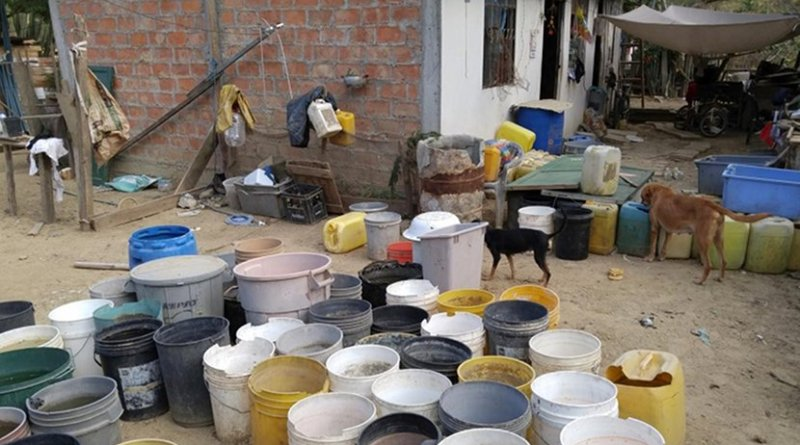 The lack of reliable access to water led people to store water around their home, increasing the number of places for mosquitoes (especially Aedes aegypti) to reproduce. Credit Walking Palms Global Initiative