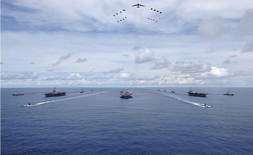 USS Nimitz (CVN 68), USS Kitty Hawk (CV 63) and USS John C. Stennis (CVN 74) Carrier Strike Groups transit in formation during a joint photo exercise. U.S. Navy photo by Mass Communication Specialist Seaman Stephen W. Rowe.