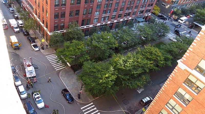 The scene of the 2017 New York City attack approximately an hour after the attack itself happened. The damaged school bus which the attacker's truck crashed into can be seen on the top left. This photo was taken from the 10th floor of Stuyvesant High School. Photo by Gh9449, Wikipedia Commons.