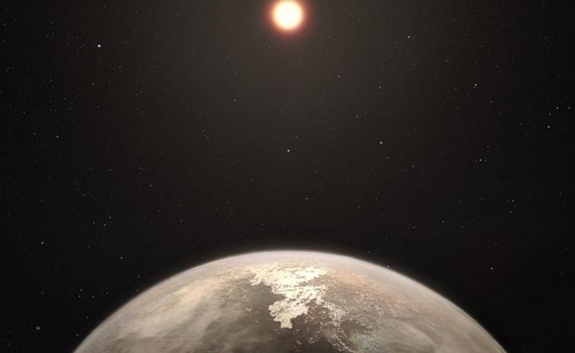 This artist's impression shows the temperate planet Ross 128 b, with its red dwarf parent star in the background. This planet, which lies only 11 light-years from Earth, was found by a team using ESO's unique planet-hunting HARPS instrument. The new world is now the second-closest temperate planet to be detected after Proxima b. It is also the closest planet to be discovered orbiting an inactive red dwarf star, which may increase the likelihood that this planet could potentially sustain life. Ross 128 b will be a prime target for ESO's Extremely Large Telescope, which will be able to search for biomarkers in the planet's atmosphere. Credit ESO/M. Kornmesser