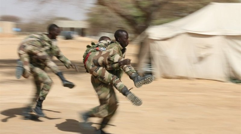 Nigerien soldiers practice buddy-carry techniques in a first aid class during Flintlock 2017 in Diffa, Niger, March 4, 2017. Flintlock is a special operations forces exercise designed to hone the capabilities of U.S. and partner-nation military units in Trans-Saharan Africa. Army photo by Staff Sgt. Kulani Lakanaria