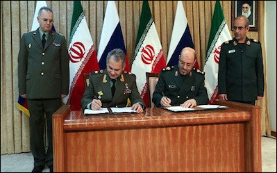 Russia's defense minister Sergei Shoigu (seated, left) and Iranian counterpart Hossein Dehghan sign an agreement to expand military ties, Tehran, January 2015. Not since World War II, has Tehran permitted a foreign country to base itself in Iran, but in August 2016, it allowed Moscow to use its Hamedan base.