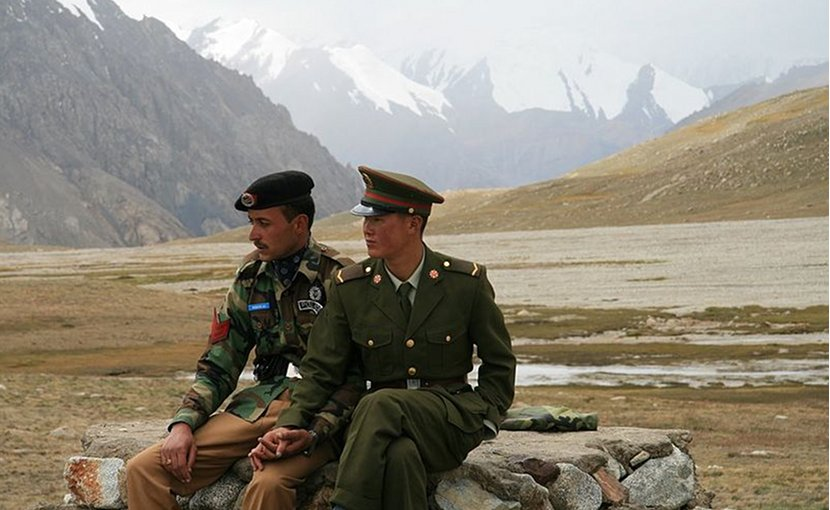 Chinese and Pakistan border guards at Khunjerab Pass. Photo by Anthony Maw, Wikimedia Commons.