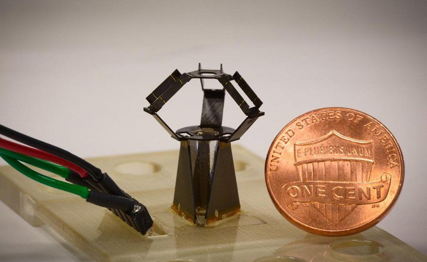 Completely unfolded, the milliDelta with 12 mm-by-15 mm-20 mm roughly compares to a cent piece, and uses piezoelectric actuators and flexural joints in its three arms to control high-frequency movements of a stage on top. Credit Wyss Institute at Harvard University.