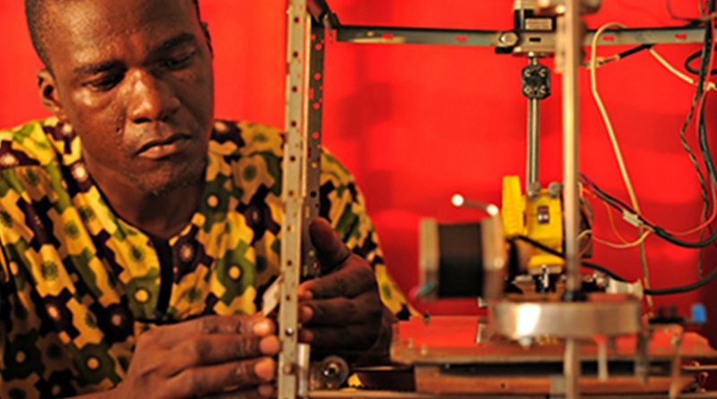 Afate Gnikou, award-winning inventor from Togo, demonstrates his 3-D printer made from e-waste.