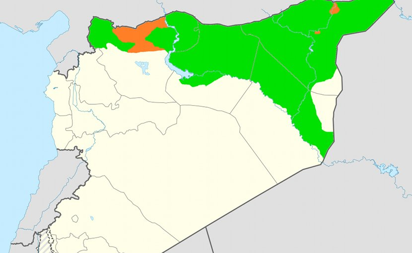 Claimed territory of Rojava (in orange) not currently under control and the de facto territory controlled by the Syrian Democratic Forces (in green). Source: Wikipedia Commons.