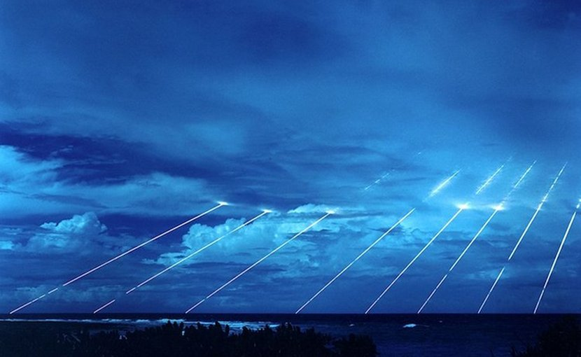 Testing of the Peacekeeper re-entry vehicles at the Kwajalein Atoll. All eight fired from only one missile. Each line, if its warhead were live, represents the potential explosive power of about 300 kilotons of TNT, about nineteen times larger than the detonation of the atomic bomb in Hiroshima. Credit: Wikimedia Commons.