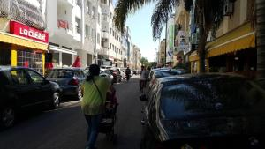 Cafés and cars occupy the sidewalk in Agdal, Rabat and pedestrians are unlawfully pushed in the narrow roads at the mercy of crazy drivers (Photo: M. Chtatou)