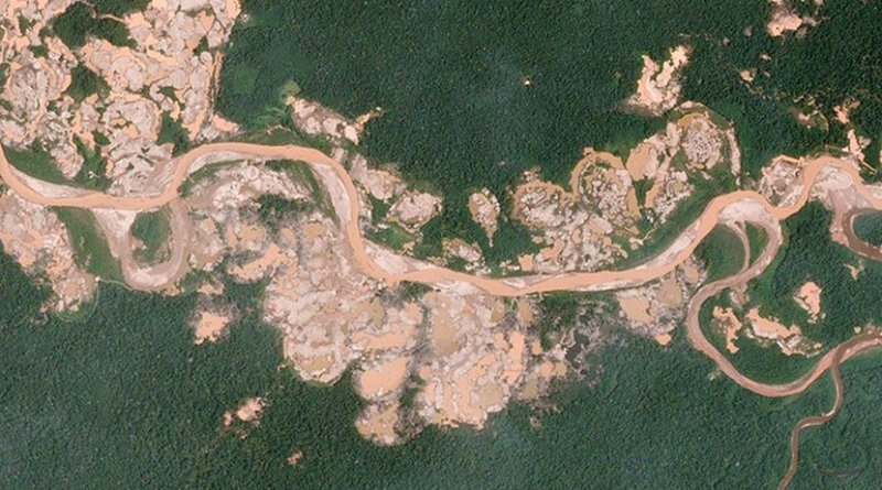 "The sprawling ""La Pampa"" gold mine has grown quickly over the years. In 2016, however, the mine spilled south of the Malinowski River, illegally entering the Tambopata National Reserve—a protected forest. The Amazon Conservation Association used Planet data to publish a series of alerts which tracked hundreds of hectares of illegal expansion and mapped alterations to the course of the Malinowski River. The Peruvian government has intervened and is now actively targeting illegally cited mining equipment inside the reserve. Photo by Planet Labs, Inc., Wikimedia Commons."
