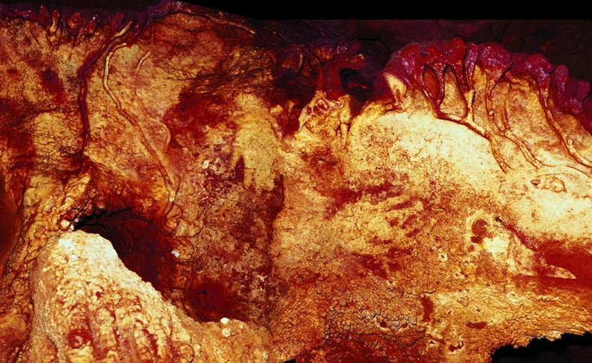 Panel 3 in Maltravieso Cave showing 3 hand stencils (centre right, centre top and top left). One has been dated to at least 66,000 years ago and must have been made by a Neanderthal (colour enhanced). Credit H. Collado